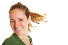Happy young woman with flying hair Royalty Free Stock Photos