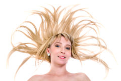 Happy young woman with flying hair on white Royalty Free Stock Photos