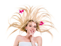 Happy young woman with flying hair on white Royalty Free Stock Photo