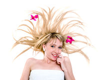 Happy young woman with flying hair on white Stock Photo