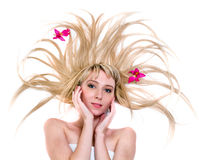 Happy young woman with flying hair on white Stock Photos
