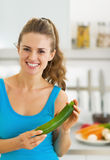 Happy young woman with fresh zucchini Stock Photo