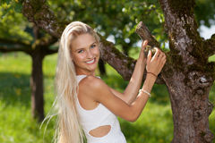 Happy young woman in a garden outdoor Stock Photography