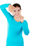Happy young woman gesturing frame Royalty Free Stock Images