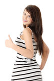 Happy young woman gesturing OK. Stock Photography