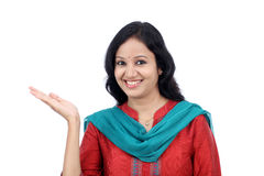 Happy young woman gesturing an open hand Royalty Free Stock Images