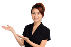 Happy young woman gesturing. Portrait of happy young Asian woman gesturing with hands, white background Royalty Free Stock Photo