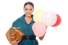 Happy young woman with gift for birthday Stock Images