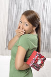 Happy young woman with gift box. Stock Photo