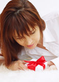 Happy young woman with gift box Stock Photo