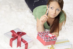 Happy young woman with gift boxes Royalty Free Stock Images