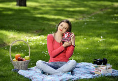 Happy young woman with gift boxes Royalty Free Stock Photography