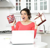 Happy young woman with gift boxes Stock Photos