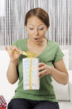 Happy young woman with gift boxes Stock Photo