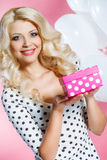 Happy young woman with gift royalty free stock photography
