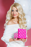 Happy young woman with gift Stock Photography