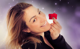 Happy young woman with gift for Valentines Day Royalty Free Stock Photography