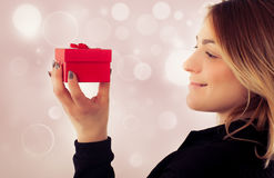 Happy young woman with gift for Valentines Day Stock Photography