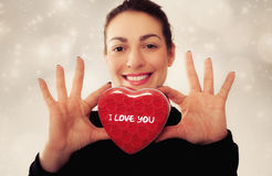Happy young woman with gift for Valentines Day Royalty Free Stock Photos