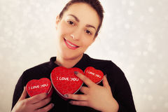 Happy young woman with gift for Valentines Day Royalty Free Stock Images