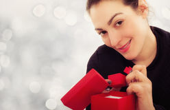 Happy young woman with gift for Valentines Day Royalty Free Stock Photo