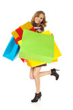 Happy young woman gifts bags colorful Royalty Free Stock Image