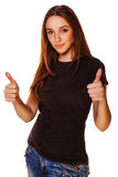 Happy young woman girl shows positive sign thumbs Stock Photography