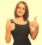 Happy young woman girl a shows positive studio sign thumbs yes, Royalty Free Stock Photography