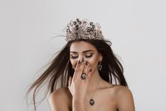 Happy young woman girl smiling shy. Beauty queen stock photography