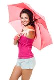 Happy young woman give a hand with color pink umbr Royalty Free Stock Image