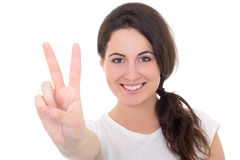 Happy young woman giving peace sign isolated on white Royalty Free Stock Photos