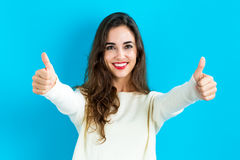 Happy young woman giving thumbs up Stock Image