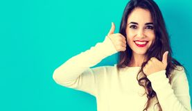 Happy young woman giving thumbs up Royalty Free Stock Images