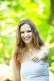 Happy young woman giving a thumbs up Royalty Free Stock Photography