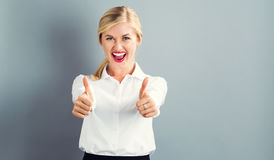 Happy young woman giving a thumbs up Royalty Free Stock Photos