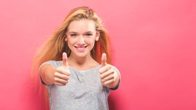 Happy young woman giving thumbs up Royalty Free Stock Image