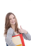 Happy young woman giving a thumbs up Stock Images