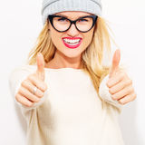 Happy young woman giving thumbs up Stock Photography