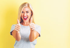 Happy young woman giving thumbs up Royalty Free Stock Photo
