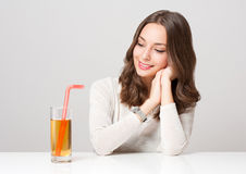 Happy young woman with glass of fruit juice. Stock Images