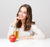 Happy young woman with glass of fruit juice. stock photo