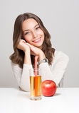Happy young woman with glass of fruit juice. Royalty Free Stock Images