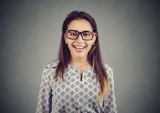 Happy young woman in glasses royalty free stock photography