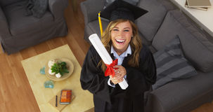 Happy young woman graduate holding diploma Stock Images