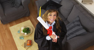 Happy young woman graduate holding diploma Royalty Free Stock Images