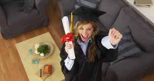 Happy young woman graduate holding diploma Royalty Free Stock Photos