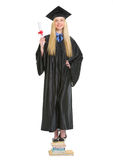 Happy young woman in graduation gown with diploma Stock Photo