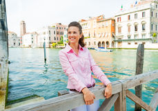 Happy young woman on grand canal in venice, italy Stock Photography