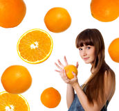 Happy young woman with grapefruit Royalty Free Stock Images