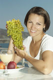Happy young woman with grapes Royalty Free Stock Image